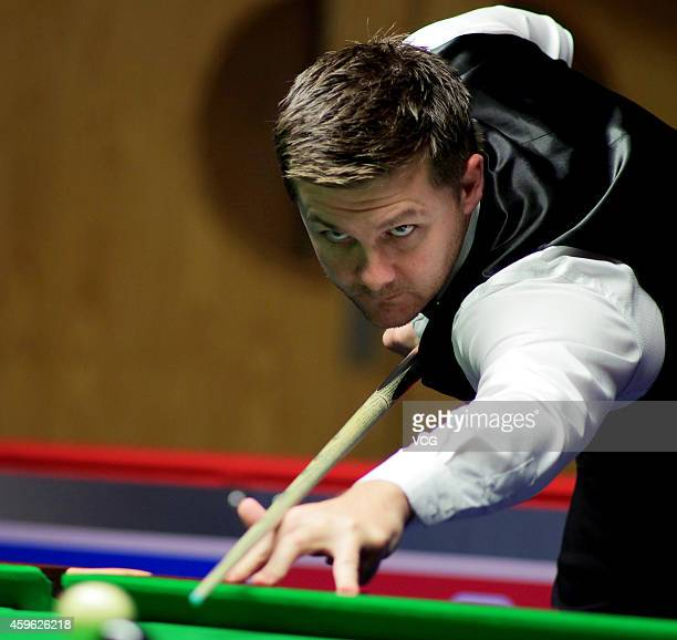 Ryan Day of Wales plays s shot against Lyu Chenwei of China on day two of 2014 Coral UK Championship at York Barbican Centre on November 26 2014 in...