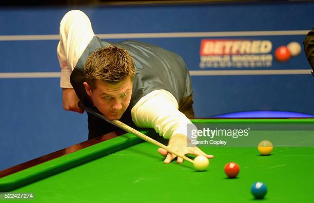 Ryan Day plays a shot against John Higgins during their first round match of the World Snooker Championship at Crucible Theatre on April 19 2016 in...