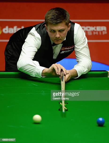 Ryan Day plays a shot against Judd Trump during their second round match in The Dafabet World Snooker Championship at Crucible Theatre on April 26...