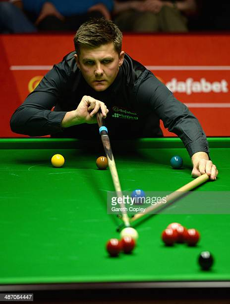 Ryan Day plays a shot against Judd Trump during their second round match in The Dafabet World Snooker Championship at Crucible Theatre on April 27...