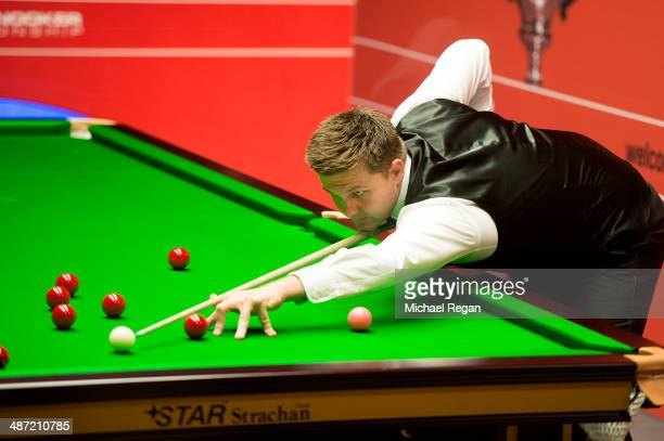 Ryan Day plays a shot against Judd Trump during their second round match in The Dafabet World Snooker Championship at the Crucible Theatre on April...
