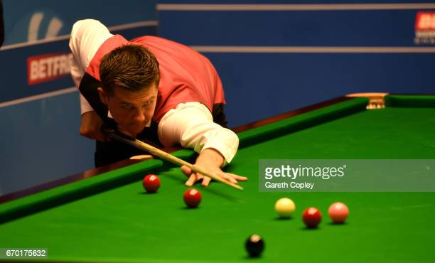 Ryan Day plays up a shot against Xiao Guodong during their first round match of the World Snooker Championship at Crucible Theatre on April 19 2017...
