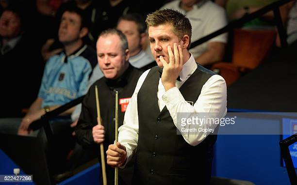 Ryan Day reacts after missing a shot against John Higgins during their first round match of the World Snooker Championship at Crucible Theatre on...
