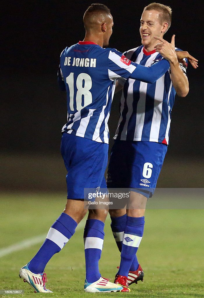 Ryan de Jong of Maritzburg Utd with Michael Morton Captain of Maritzburg Utd during the Absa Premiership match between Maritzburg United and MP Black Aces at Harry Gwala Stadium on September 18, 2013 in Durban, South Africa.