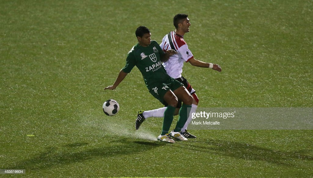 Ryan De Vries of Bentleigh Greens and Yianni Fragogianni of Blacktown City compete for the ball during the FFA Cup match between Blacktown City and Bentleigh Greens at Lilys Football Centre on August 12, 2014 in Blacktown, Australia.