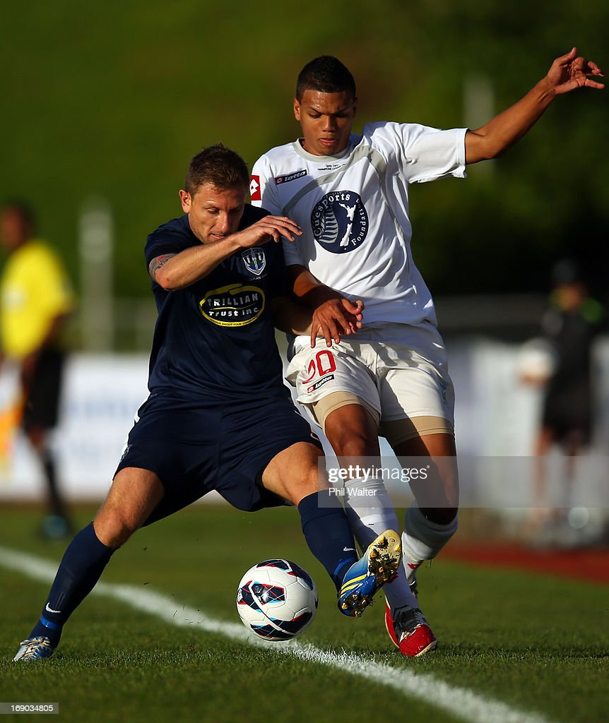 Ryan De Vries of Waitakere (R) and James Pritchett (L) of Auckland contest the ball during the OFC Champions League Final match between Auckland and Waitakere at Mt Smart Stadium on May 19, 2013 in Auckland, New Zealand.