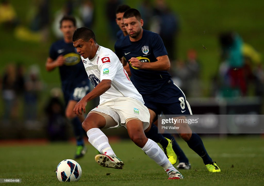 Ryan De Vries of Waitakere takes the ball forward during the OFC Champions League Final match between Auckland and Waitakere at Mt Smart Stadium on May 19, 2013 in Auckland, New Zealand.