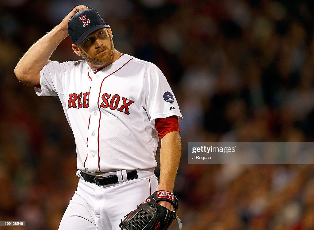 <a gi-track='captionPersonalityLinkClicked' href=/galleries/search?phrase=Ryan+Dempster&family=editorial&specificpeople=211606 ng-click='$event.stopPropagation()'>Ryan Dempster</a> #46 of the Boston Red Sox reacts against the Minnesota Twins in the first inning at Fenway Park on May 7, 2013 in Boston, Massachusetts.