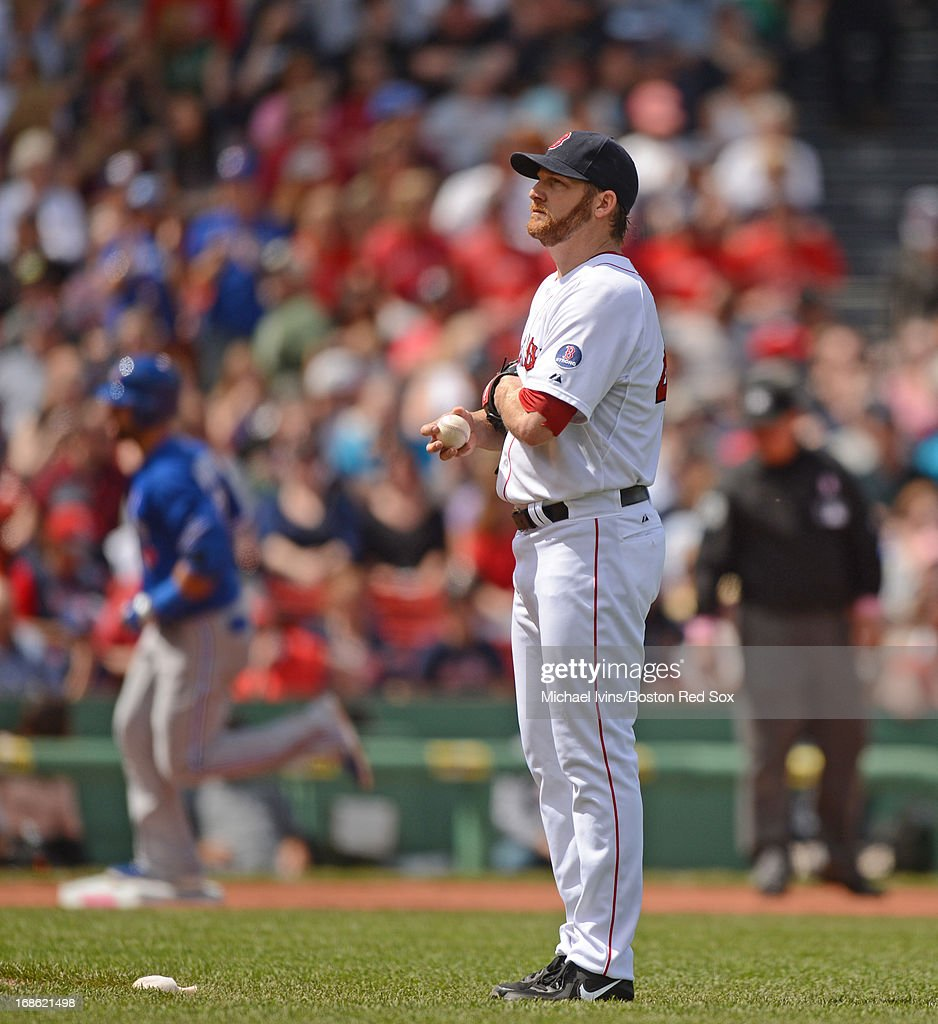 <a gi-track='captionPersonalityLinkClicked' href=/galleries/search?phrase=Ryan+Dempster&family=editorial&specificpeople=211606 ng-click='$event.stopPropagation()'>Ryan Dempster</a> #46 of the Boston Red Sox stands on the mound after allowing a home run to Jose Bautista #19 of the Toronto Blue Jays in the third inning on May 12, 2013 at Fenway Park in Boston, Massachusetts.