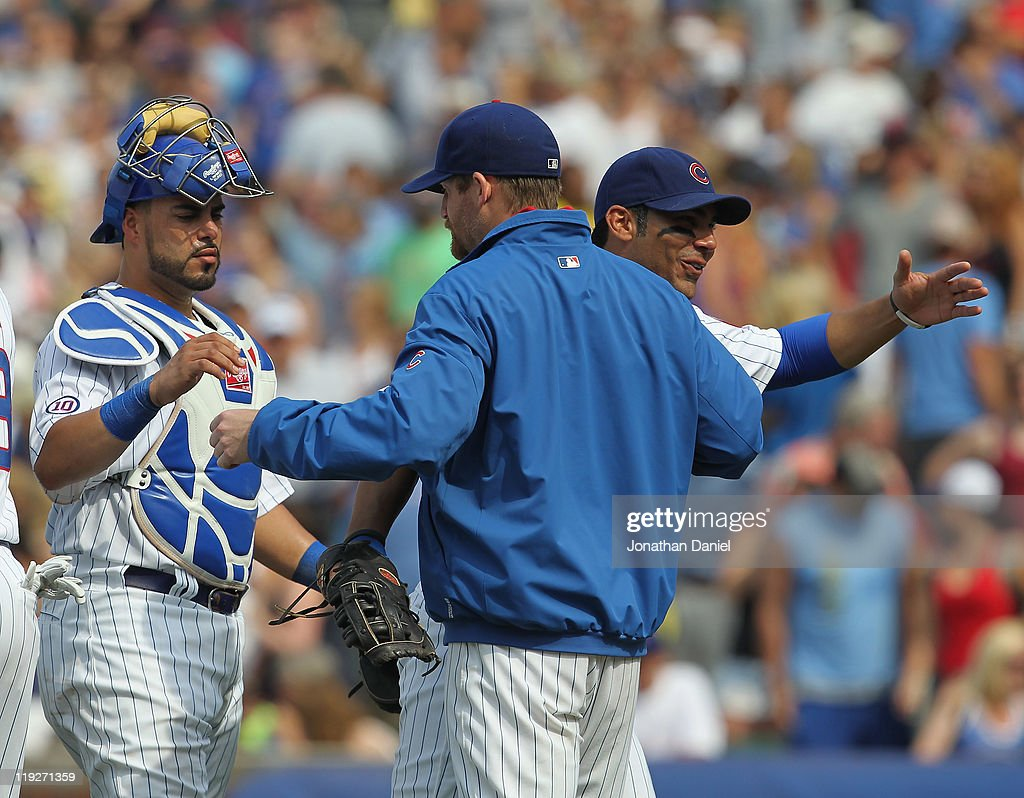 <a gi-track='captionPersonalityLinkClicked' href=/galleries/search?phrase=Ryan+Dempster&family=editorial&specificpeople=211606 ng-click='$event.stopPropagation()'>Ryan Dempster</a> #46 of the Chicago Cubs (center) is congratulated by teammates <a gi-track='captionPersonalityLinkClicked' href=/galleries/search?phrase=Geovany+Soto&family=editorial&specificpeople=743668 ng-click='$event.stopPropagation()'>Geovany Soto</a> #18 (L) and Carlos Pena #22 after a win over the Florida Marlins at Wrigley Field on July 15, 2011 in Chicago, Illlinois. The Cubs defeated the Marlins 2-1.