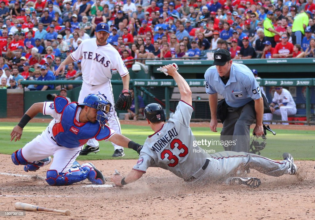 <a gi-track='captionPersonalityLinkClicked' href=/galleries/search?phrase=Ryan+Dempster&family=editorial&specificpeople=211606 ng-click='$event.stopPropagation()'>Ryan Dempster</a> #46 of the Texas Rangers and home plate umpire Chris Conroy #98 looks on as <a gi-track='captionPersonalityLinkClicked' href=/galleries/search?phrase=Geovany+Soto&family=editorial&specificpeople=743668 ng-click='$event.stopPropagation()'>Geovany Soto</a> #8 tags <a gi-track='captionPersonalityLinkClicked' href=/galleries/search?phrase=Justin+Morneau&family=editorial&specificpeople=211556 ng-click='$event.stopPropagation()'>Justin Morneau</a> #33 of the Minnesota Twins at Rangers Ballpark in Arlington on August 25, 2012 in Arlington, Texas.