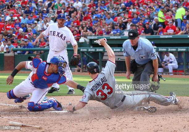 Ryan Dempster of the Texas Rangers and home plate umpire Chris Conroy looks on as Geovany Soto tags Justin Morneau of the Minnesota Twins at Rangers...