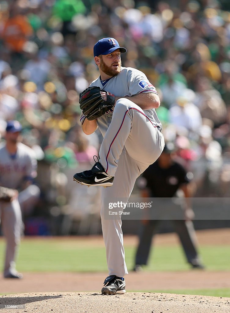 <a gi-track='captionPersonalityLinkClicked' href=/galleries/search?phrase=Ryan+Dempster&family=editorial&specificpeople=211606 ng-click='$event.stopPropagation()'>Ryan Dempster</a> #46 of the Texas Rangers pitches against the Oakland Athletics at O.co Coliseum on October 3, 2012 in Oakland, California.