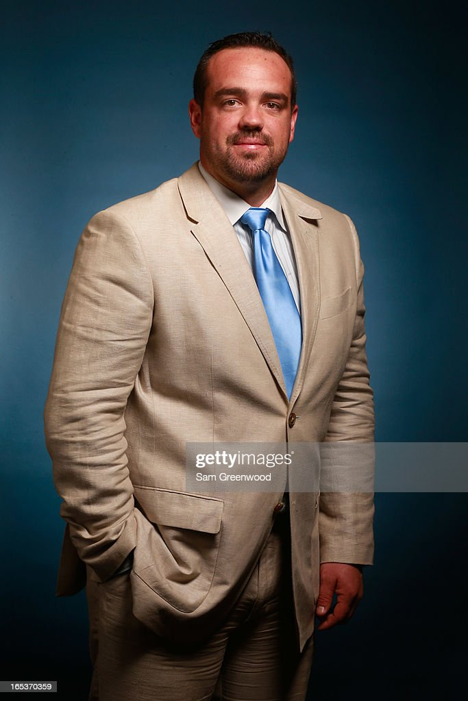 Ryan DiNunzio, Senior Marketing manager of RSM poses at the World Congress Of Sports Executive Portrait Studio on April 3, 2013 in Naples, Florida.