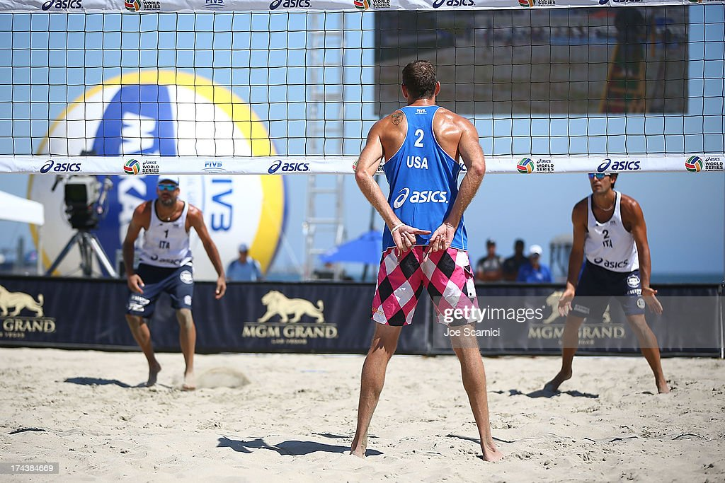 Ryan Doherty (center) of USA signals his partner to serve to either Gianluca Casadei (L) of Italy or his teammage Paolo Ficosecco during the round of pool play at the ASICS World Series of Beach Volleyball - Day 3 on July 24, 2013 in Long Beach, California.