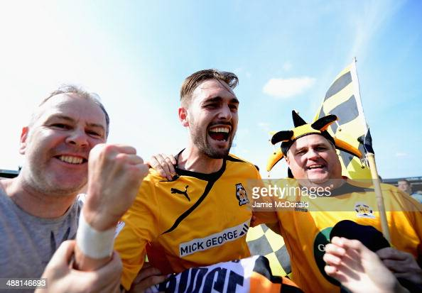 Ryan Donaldson of Cambride United celebrates with the crowd during the Skrill Conference Premier PlayOffs SemiFinal match between Cambridge United...