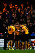 Ryan Donaldson of Cambridge is congratulated by team mates after making it 20 during the FA Cup Third Round match between Cambridge United and Luton...