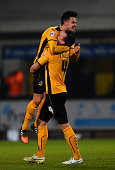 Ryan Donaldson of Cambridge United celebrates with teammate Josh Coulson after the FA Cup Fourth Round match between Cambridge United and Manchester...