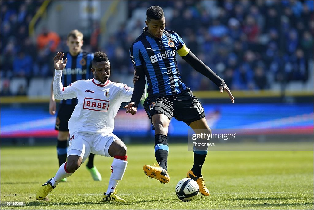 Ryan Donk of Club Brugge KV is challenged by Imoh Ezekiel of Standard during the Jupiler League match between Club Brugge and Standard de Liege on April 01, 2013 in the Jan Breydel Stadium in Brugge, Belgium.
