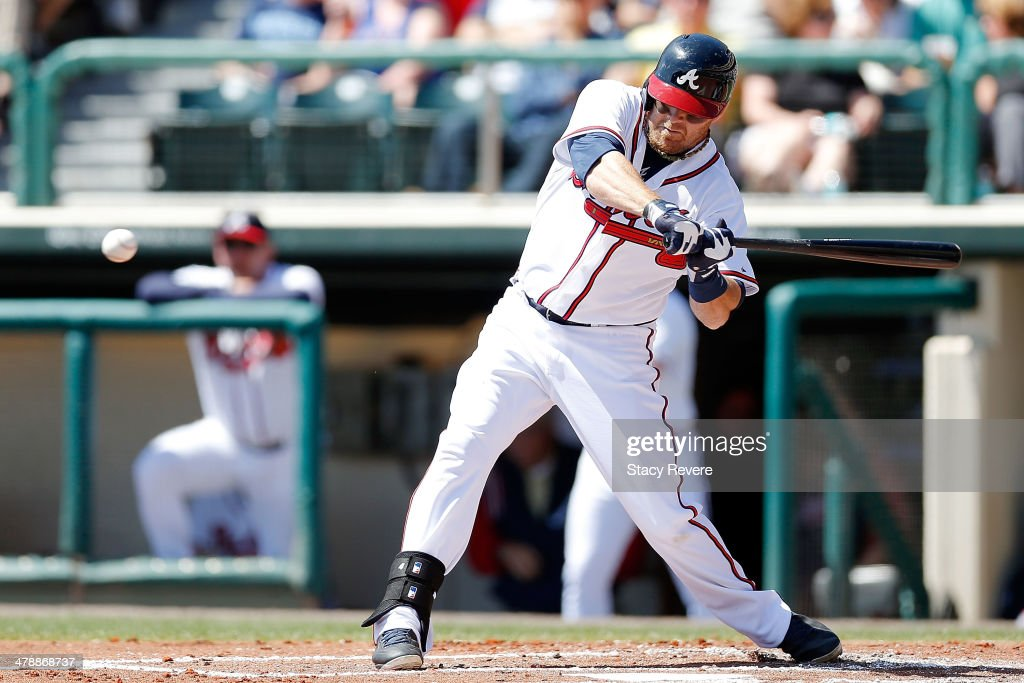 <a gi-track='captionPersonalityLinkClicked' href=/galleries/search?phrase=Ryan+Doumit&family=editorial&specificpeople=598785 ng-click='$event.stopPropagation()'>Ryan Doumit</a> #4 of the Atlanta Braves swings at a pitch in the second inning of a game against the Tampa Bay Rays at Champion Stadium on March 14, 2014 in Lake Buena Vista, Florida. Atlanta won the game 6-1.