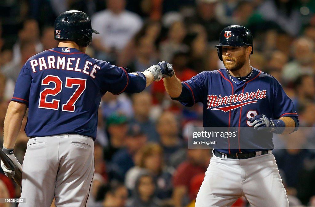 <a gi-track='captionPersonalityLinkClicked' href=/galleries/search?phrase=Ryan+Doumit&family=editorial&specificpeople=598785 ng-click='$event.stopPropagation()'>Ryan Doumit</a> #9 of the Minnesota Twins celebrates his home run with Chris Parmelee in the 7th inning against the Boston Red Sox at Fenway Park on May 7, 2013 in Boston, Massachusetts.