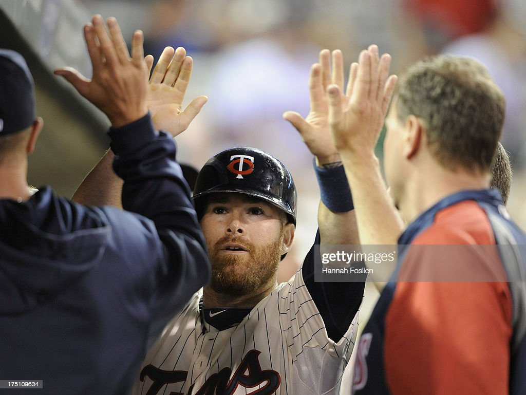 <a gi-track='captionPersonalityLinkClicked' href=/galleries/search?phrase=Ryan+Doumit&family=editorial&specificpeople=598785 ng-click='$event.stopPropagation()'>Ryan Doumit</a> #9 of the Minnesota Twins celebrates scoring a run against the Kansas City Royals during the eighth inning of the game on July 31, 2013 at Target Field in Minneapolis, Minnesota. The Royals defeated the Twins 4-3.