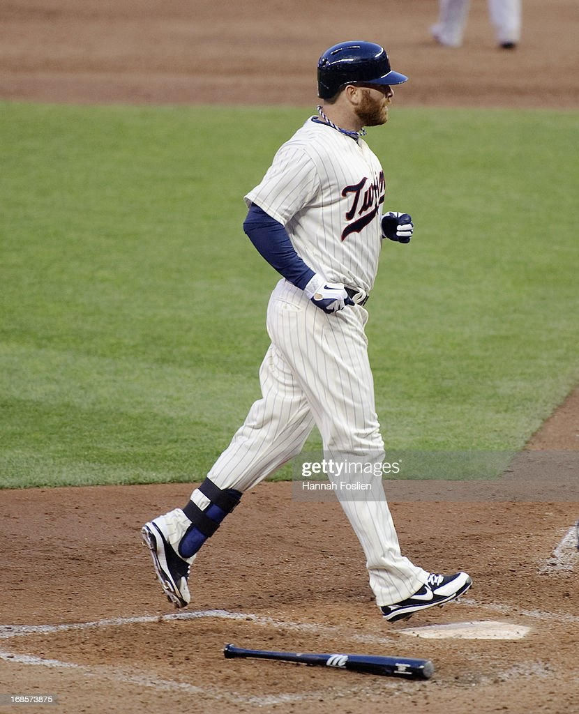 <a gi-track='captionPersonalityLinkClicked' href=/galleries/search?phrase=Ryan+Doumit&family=editorial&specificpeople=598785 ng-click='$event.stopPropagation()'>Ryan Doumit</a> #9 of the Minnesota Twins crosses home plate after hitting a two run home run against the Baltimore Orioles during the sixth inning of the game on May 11, 2013 at Target Field in Minneapolis, Minnesota.