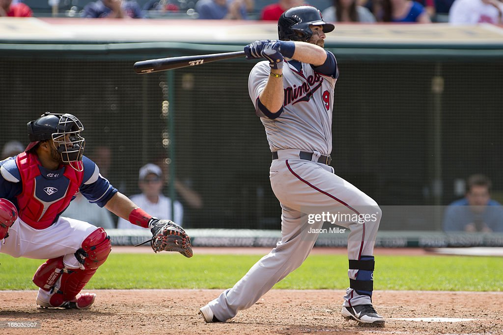 <a gi-track='captionPersonalityLinkClicked' href=/galleries/search?phrase=Ryan+Doumit&family=editorial&specificpeople=598785 ng-click='$event.stopPropagation()'>Ryan Doumit</a> #9 of the Minnesota Twins hits an RBI single during the eighth inning against the Cleveland Indians at Progressive Field on May 4, 2013 in Cleveland, Ohio.