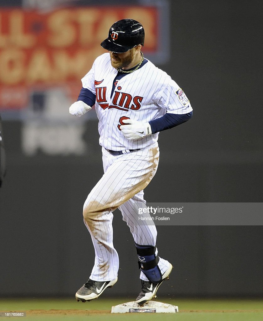 <a gi-track='captionPersonalityLinkClicked' href=/galleries/search?phrase=Ryan+Doumit&family=editorial&specificpeople=598785 ng-click='$event.stopPropagation()'>Ryan Doumit</a> #9 of the Minnesota Twins rounds the bases after hitting a solo home run against the Detroit Tigers during the seventh inning of the game on September 24, 2013 at Target Field in Minneapolis, Minnesota. The Tigers defeated the Twin 4-2.