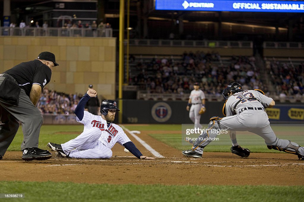 <a gi-track='captionPersonalityLinkClicked' href=/galleries/search?phrase=Ryan+Doumit&family=editorial&specificpeople=598785 ng-click='$event.stopPropagation()'>Ryan Doumit</a> #9 of the Minnesota Twins scores ahead of the tag of <a gi-track='captionPersonalityLinkClicked' href=/galleries/search?phrase=Alex+Avila&family=editorial&specificpeople=5749211 ng-click='$event.stopPropagation()'>Alex Avila</a> #13 of the Detroit Tigers in the second inning on September 24, 2013 at Target Field in Minneapolis, Minnesota. The Tigers win 4-2.