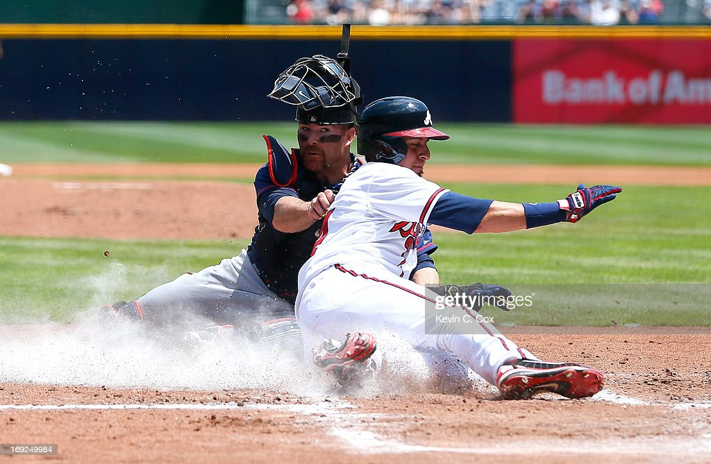Ryan Doumit #9 of the Minnesota Twins tags out Ramiro Pena #14 of the Atlanta Braves at homeplate in the first inning at Turner Field on May 22, 2013 in Atlanta, Georgia.