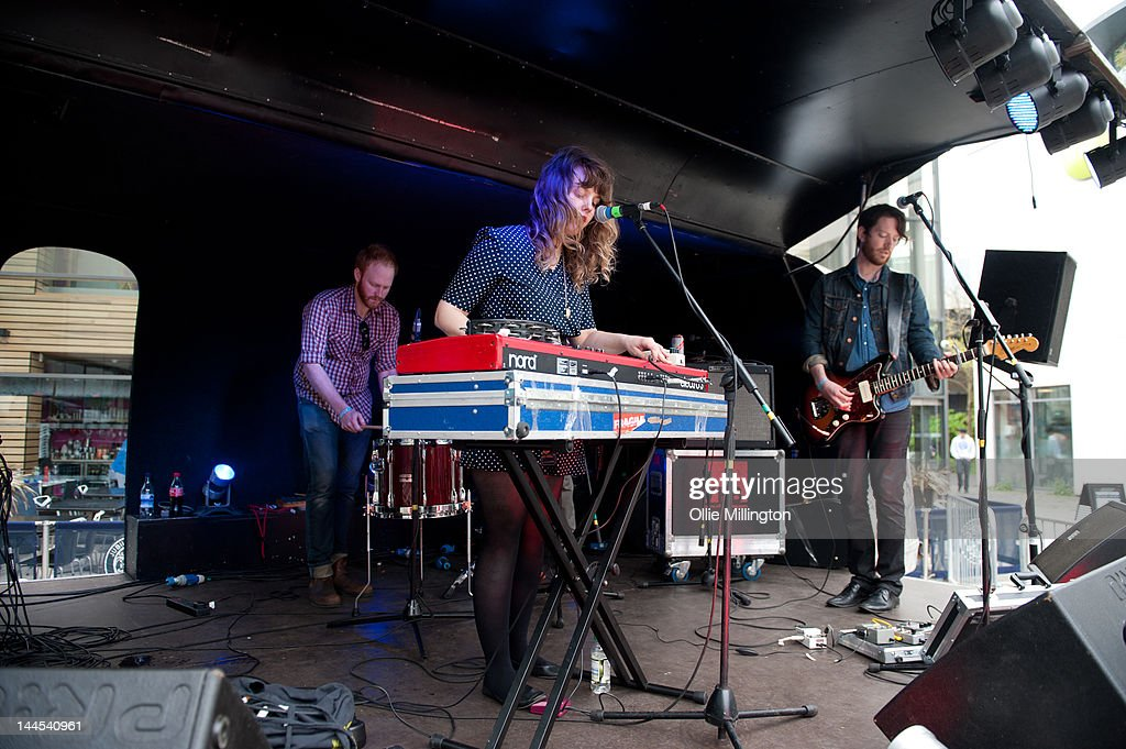 Ryan Drabble, Jeanette Stewart and Tyson McShane of Slow Down, Molasses perform on stage at the Dr Martins street gig airstream trailor during The Great Escape Festival on May 10, 2012 in Brighton, United Kingdom.