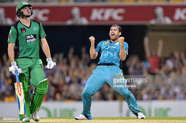 Ryan Duffield of the Heat celebrates after taking the wicket of David Hussey of the Stars during the Big Bash League match between the Brisbane Heat...