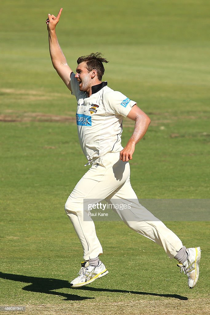 Ryan Duffield of the Warriors celebrates the wicket of Luke Butterworth of the Tigers during day three of the Sheffield Shield match between the Western Australia Warriors and the Tasmania Tigers at the WACA on February 14, 2014 in Perth, Australia.