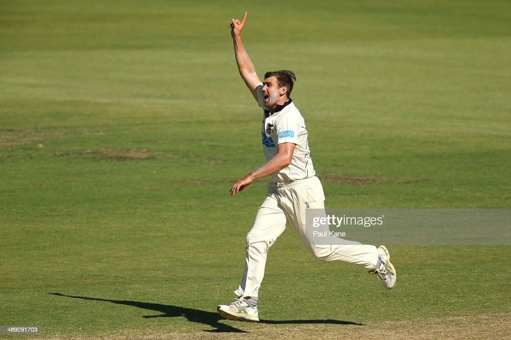 Ryan Duffield of the Warriors celebrates the wicket of Xavier Doherty of the Tigers during day three of the Sheffield Shield match between the Western Australia Warriors and the Tasmania Tigers at the WACA on February 14, 2014 in Perth, Australia.