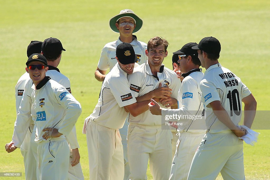 Ryan Duffield of the Warriors celebrates with team mates after dismissing Ben Dunk of the Tigers during day three of the Sheffield Shield match between the Western Australia Warriors and the Tasmania Tigers at the WACA on February 14, 2014 in Perth, Australia.