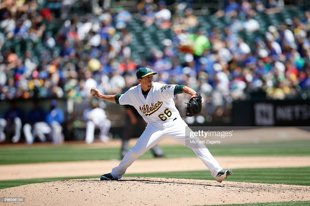 Ryan Dull of the Oakland Athletics pitches during the game against the Chicago Cubs at the Oakland Coliseum on August 7 2016 in Oakland California...