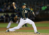 Ryan Dull of the Oakland Athletics pitches in the tenth inning against the Tampa Bay Rays at the OaklandAlameda Coliseum on July 22 2016 in Oakland...