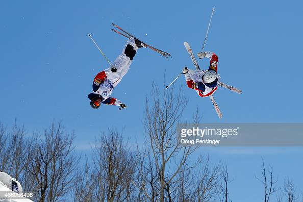 Ryan Dyer and Bryon Wilson go airborne during their match up in the men's dual moguls at the 2015 US Freestyle Ski National Championships at...