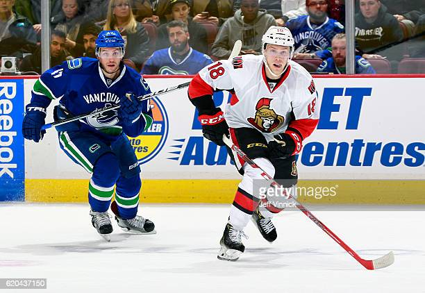 Ryan Dzingel of the Ottawa Senators and Sven Baertschi of the Vancouver Canucks skate up ice during their NHL game at Rogers Arena October 25 2016 in...