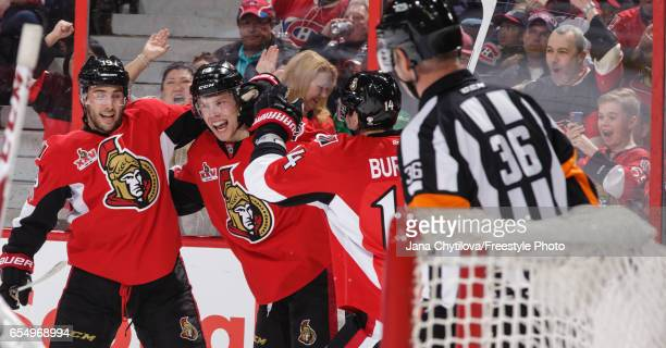 Ryan Dzingel of the Ottawa Senators celebrates his second period goal against the Montreal Canadiens with team mates Derick Brassard sand Alexandre...
