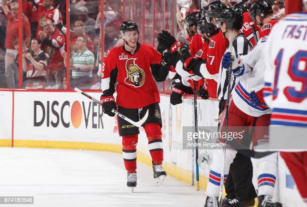 Ryan Dzingel of the Ottawa Senators celebrates his second period goal against the New York Rangers with teammates at the players bench in Game One of...