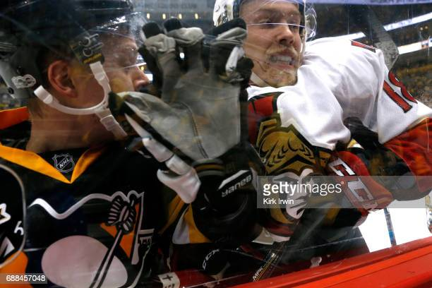 Ryan Dzingel of the Ottawa Senators checks Olli Maatta of the Pittsburgh Penguins during the first period in Game Seven of the Eastern Conference...