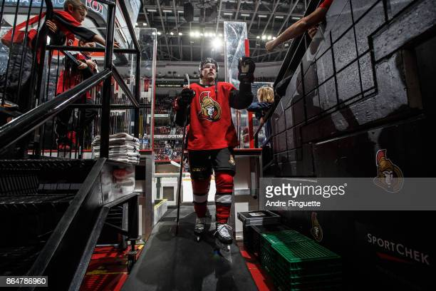 Ryan Dzingel of the Ottawa Senators highfives a fan as he leaves the ice after warmup prior to a game against the Toronto Maple Leafs at Canadian...