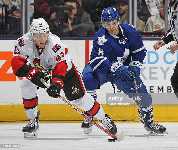 Ryan Dzingel of the Ottawa Senators skates against Connor Carrick of the Toronto Maple Leafs during an NHL game at the Air Canada Centre on March...