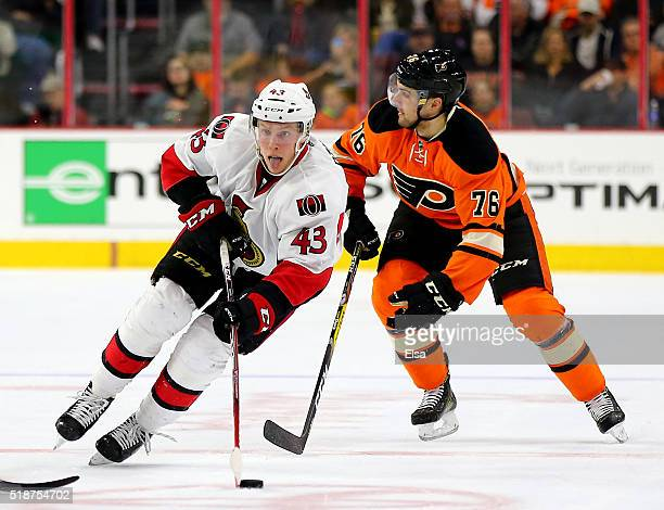 Ryan Dzingel of the Ottawa Senators takes the puck as Chris VandeVelde of the Philadelphia Flyers defends at the Wells Fargo Center on April 2 2016...