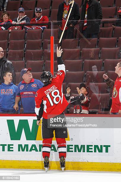 Ryan Dzingel of the Ottawa Senators throws a stick over the glass after being named third star of the game against the Montreal Canadiens at Canadian...
