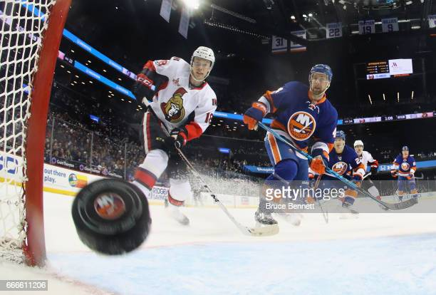 Ryan Dzingel of the Ottawa Senators watches a shot by Bobby Ryan go in the net against the New York Islanders at 1854 of the second period at the...