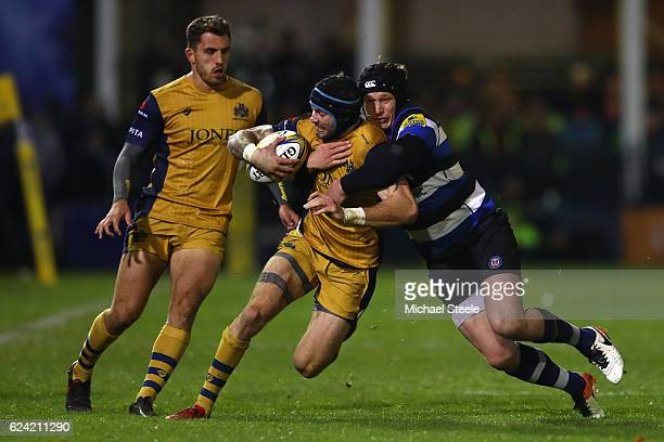 Ryan Edwards of Bristol is tackled by Jack Wilson of Bath during the Aviva Premiership match between Bath Rugby and Bristol Rugby at the Recreation...