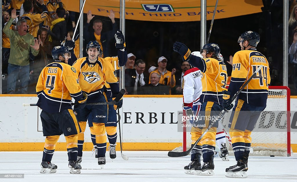 Ryan Ellis #4 celebrates his goal with Filip Forsberg #9. Colin Wilson #33 and Cody Franson #44 of the Nashville Predators against the Montreal Canadiens during an NHL game at Bridgestone Arena on March 24, 2015 in Nashville, Tennessee.